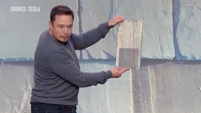 Elon Musk with his revolutionary Solar Tile